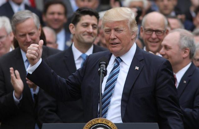 President Trump celebrateswith congressional Republicans in the Rose Garden after the House approved the American Healthcare Act. (Photo: Carlos Barria/Reuters)