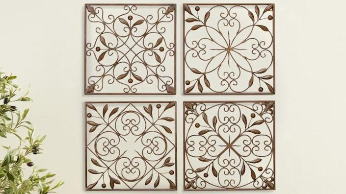 These wall decorations have a floral scrollwork motif.