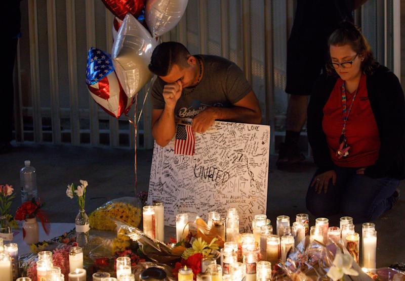 Mourners at a makeshift memorial on the Las Vegas Strip.