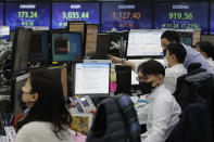 Currency traders watch monitors at the foreign exchange dealing room of the KEB Hana Bank headquarters in Seoul, South Korea, Thursday, March 4, 2021. Asian shares fell Thursday, tracking a decline on Wall Street as another rise in bond yields rattled investors who worry that higher inflation may prompt central banks to raise ultra-low interest rates. (AP Photo/Ahn Young-joon)