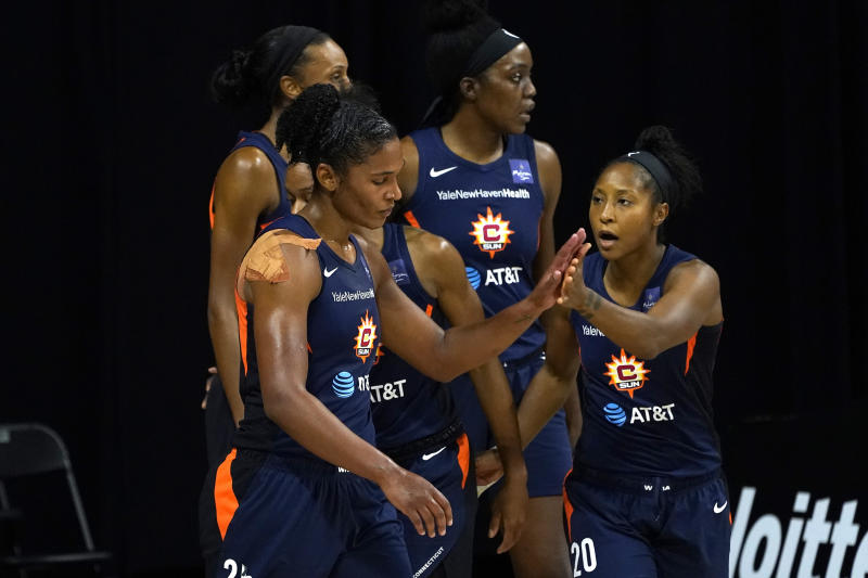 Connecticut Sun forward Alyssa Thomas (25) celebrates a basket against the Las Vegas Aces with guard Briann January (20) during the first half of Game 3 of a WNBA basketball semifinal round playoff series Thursday, Sept. 24, 2020, in Bradenton, Fla. (AP Photo/Chris O'Meara)
