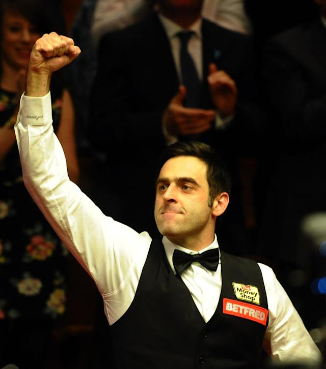 Ronnie O'Sullivan (L) of England celebrates on May 7, 2012 after beating Ali Carter of England 18-11 in the World Championship Snooker final at the Crucible Theater in Sheffield, England. AFP PHOTO/PAUL ELLISPAUL ELLIS/AFP/GettyImages