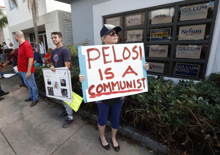 Demonstrators stand outside a building where House Minority Leader Nancy Pelosi spoke at a get-out-the-vote event for Florida Democratic congressional candidates Donna Shalala and Debbie Mucarsel-Powell on Oct. 17, 2018, in Coral Gables, Fla. (Photo: Wilfredo Lee/AP)