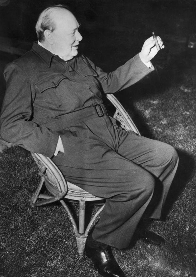Churchill wears a siren suit as he relaxes in a garden chair during a visit to the U.S. in January 1942. (Photo: Central Press via Getty Images)