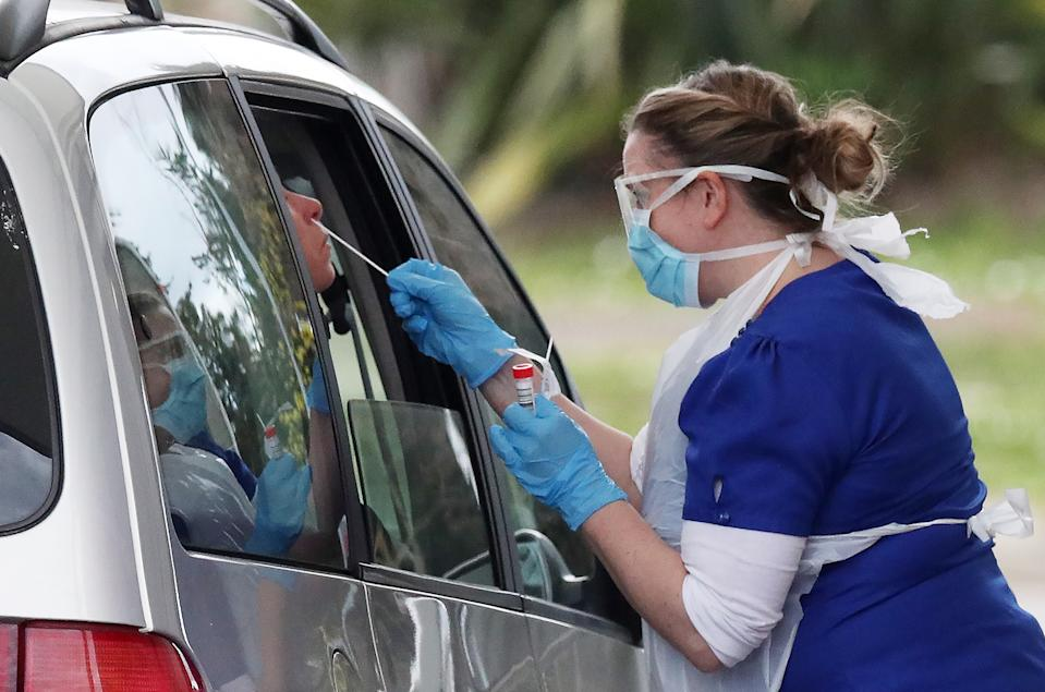 A person is swabbed at a drive-through coronavirus testing site in a car park at Chessington World of Adventures, in southwest London, as the UK continues in lockdown to help curb the spread of the coronavirus. (Photo by Jonathan Brady/PA Images via Getty Images)