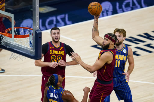 Cleveland Cavaliers center JaVale McGee (6) shoots over Indiana Pacers forward Myles Turner (33) during the second half of an NBA basketball game in Indianapolis, Thursday, Dec. 31, 2020. (AP Photo/Michael Conroy)