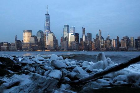 Downtown Manhattan in New York City is seen over ice that formed on the banks of the Hudson River during below freezing temperatures from Jersey City, New Jersey, U.S., February 1, 2019. REUTERS/Andrew Kelly