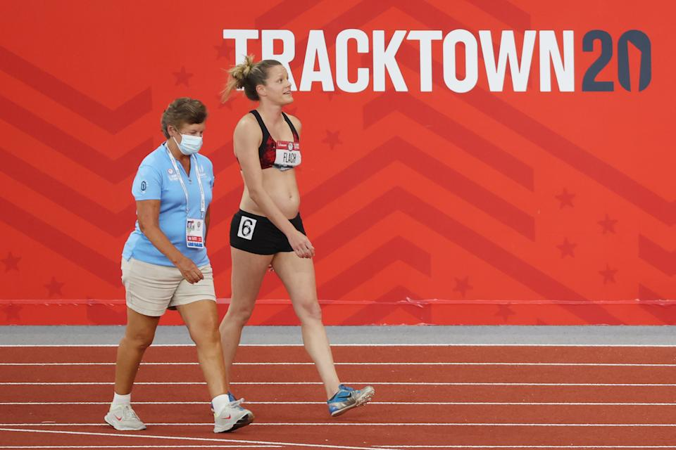 Lindsay Flach (pictured right) walks from the track after dropping out of the Women's Heptathlon 800 Meters during day ten of the 2020 US Olympic Track & Field Team Trials.