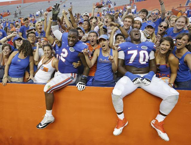 Florida defensive lineman Dominique Easley (2) and offensive linesman D.J. Humphries (70) celebrate with fans after beating Tennessee 31-17 in an NCAA college football game in Gainesville, Fla., Saturday, Sept. 21, 2013.(AP Photo/John Raoux)
