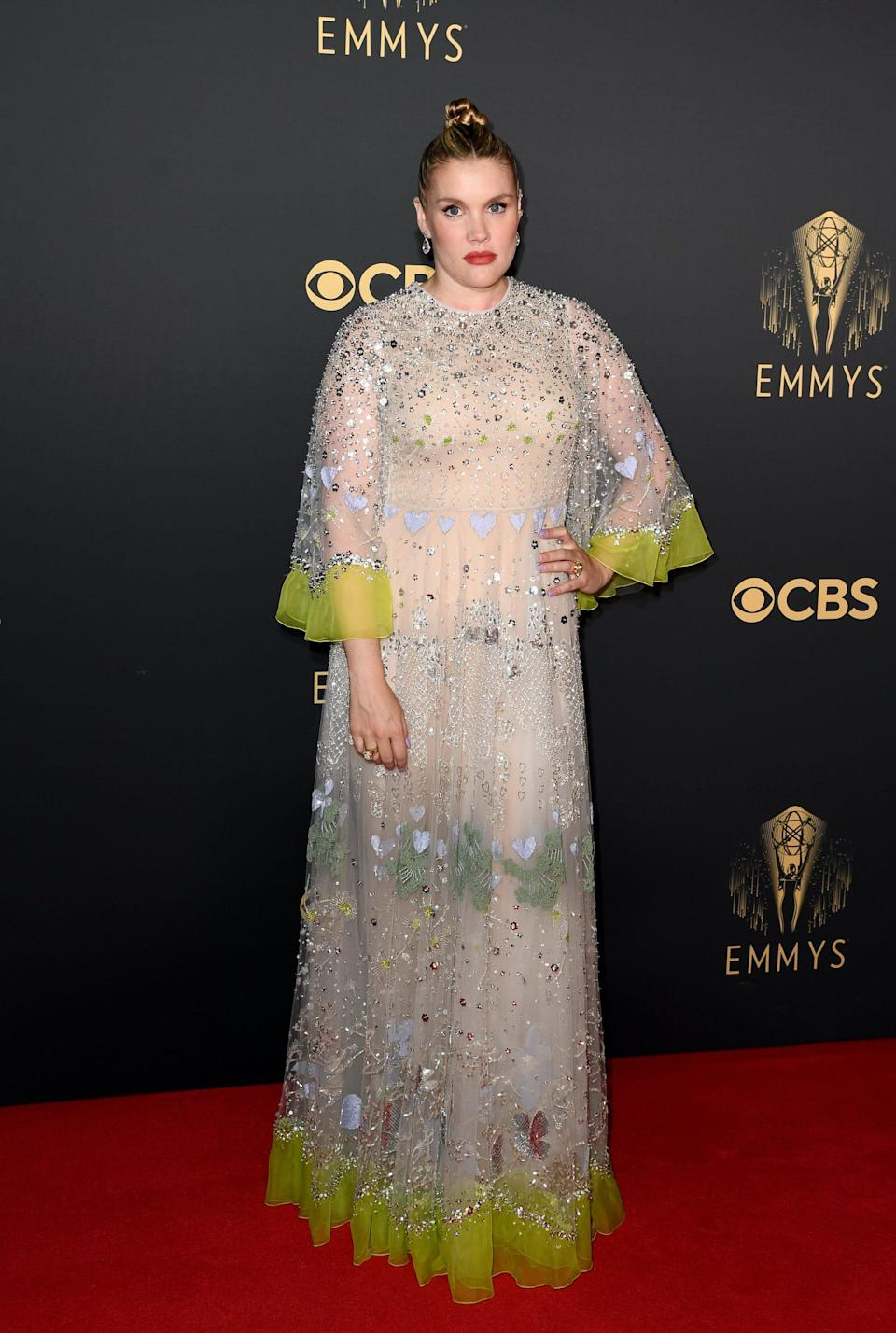 Emerald Fennell wears a sparkly, cream dress on the Emmys red carpet.