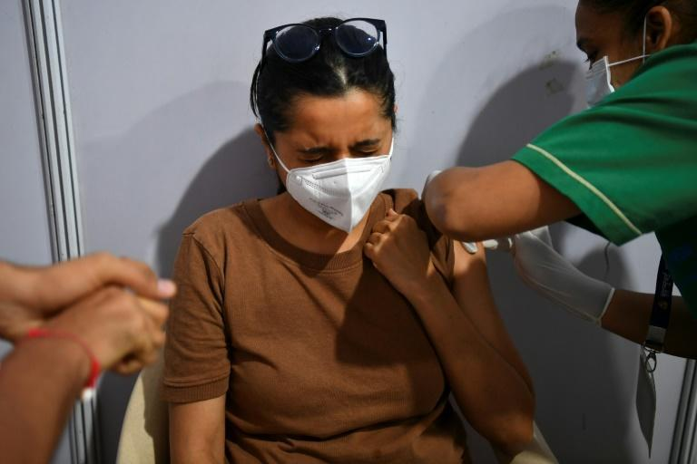 A woman is vaccinated in Mumbai