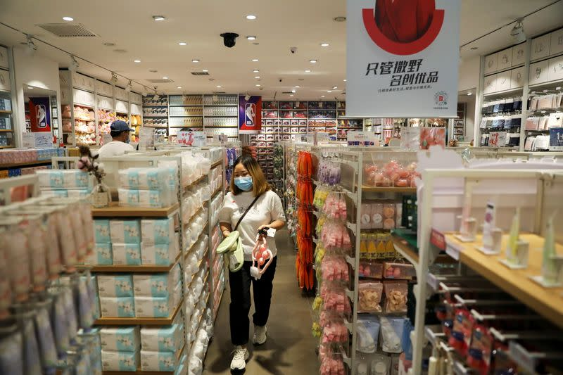 Customer shops at a store of Chinese retailer MINISO Group in Beijing