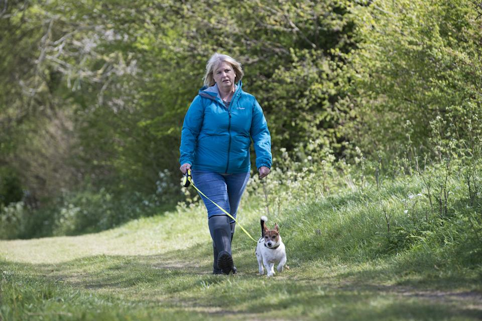 Embargoed to 1430 Tuesday May 11 An actress playing the role of PCSO Julia James walks her Jack Russell dog Toby, who was found at the scene, as they reconstruct the route taken by Julia and Toby in the fields behind her home in the hamlet of Snowdown, near Aylesham, Kent. Picture date: Tuesday May 11, 2021.