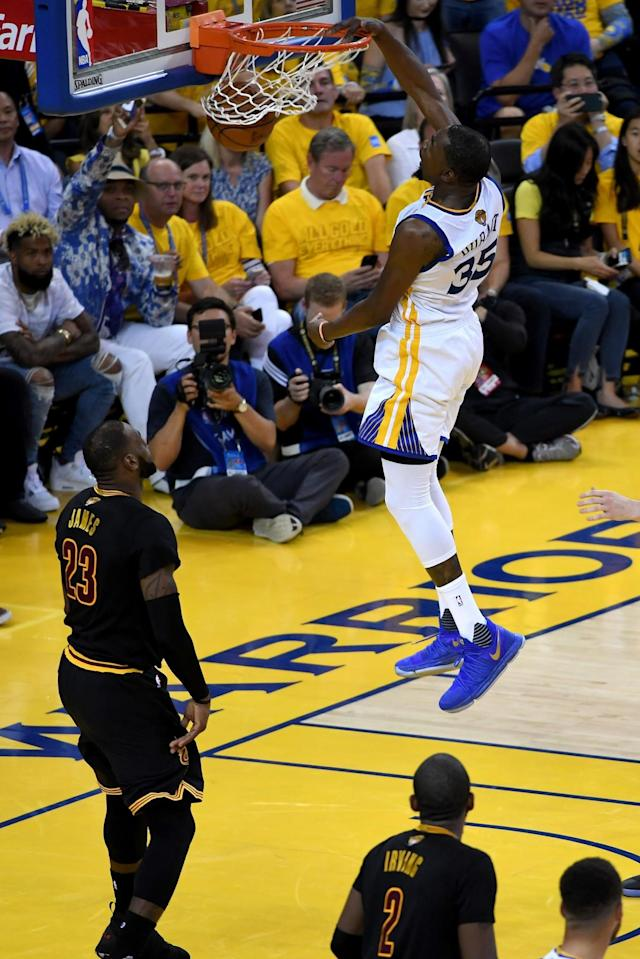 <p>Kevin Durant slam dunks on the way to 33 points as the Golden State Warriors beat the Cleveland Cavaliers 132-113 to take a 2-0 lead in the NBA finals (AFP Photo/Thearon W. Henderson) </p>