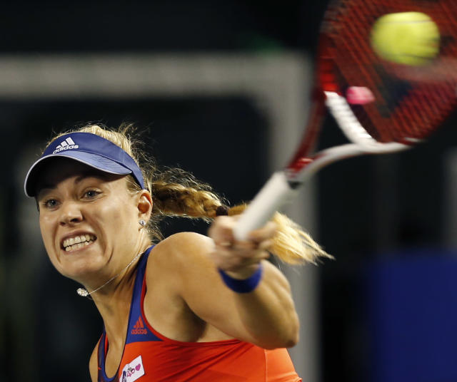 Angelique Kerber of Germany returns the ball against Caroline Wozniacki of Denmark during their semi-final match of the Pan Pacific Open tennis tournament in Tokyo, Friday, Sept. 27, 2013. (AP Photo/Koji Sasahara)