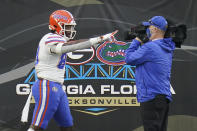 Florida tight end Kemore Gamble, left, points to a camera after scoring a touchdown against Georgia during the first half of an NCAA college football game, Saturday, Nov. 7, 2020, in Jacksonville, Fla. (AP Photo/John Raoux)