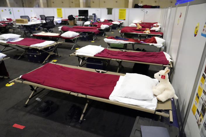 Cots are shown in a dormitory at an emergency shelter for migrant children Friday, July 2, 2021, in Pomona, Calif. The Biden administration on Friday gave a rare look inside an emergency shelter it opened to house migrant children crossing the U.S.-Mexico border alone, calling the California facility a model among its large-scale sites, some of which have been plagued by complaints. (AP Photo/Marcio Jose Sanchez, Pool)