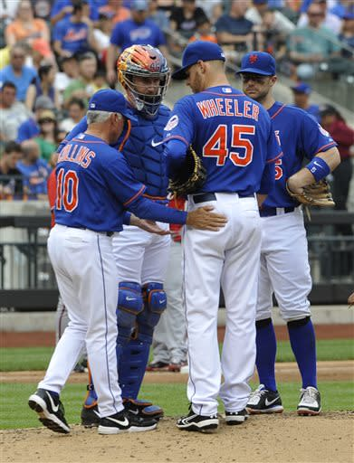 New York Mets York catcher John Buck and David Wright watch as manager Terry Collins (10) takes starting pitcher Zack Wheeler (45) out of the baseball game against the Washington Nationals' in the fifth inning at Citi Field on Sunday, June 30, 2013 in New (AP Photo/Kathy Kmonicek)