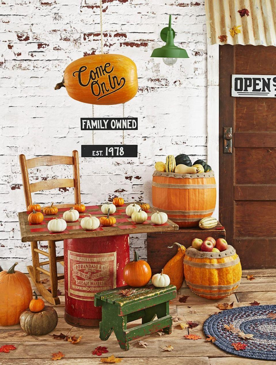 <p>Invite people to sit and stay for a friendly game of checkers with pumpkin game pieces of course! <br></p><p><strong>Make Pumpkin Checkers: </strong>Paint 32 squares on a large (roughly 30-inch) wood board with burnt orange craft paint. Use mini white and orange pumpkins as game pieces. </p>