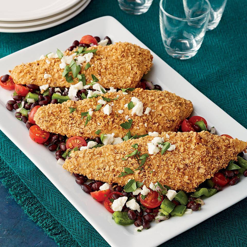 <p>This 40-minute recipe pairs a vibrant black bean salad with baked flounder. The flounder is coated in a cayenne pepper and tortilla chip crust adding a bit of heat to this Mexican-inspired meal.</p>