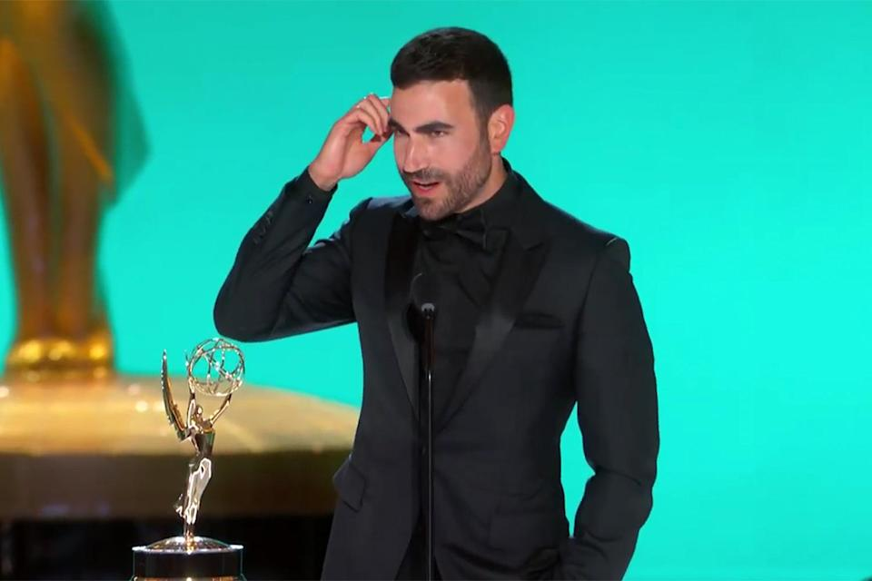 """<p>accepted his first Emmy — which <a href=""""https://people.com/tv/2021-emmy-awards-brett-goldstein-wins-supporting-actor-comedy-series-ted-lasso/"""" rel=""""nofollow noopener"""" target=""""_blank"""" data-ylk=""""slk:he won for his supporting role as Roy Kent in"""" class=""""link rapid-noclick-resp"""">he won for his supporting role as Roy Kent in </a><em><a href=""""https://people.com/tv/2021-emmy-awards-brett-goldstein-wins-supporting-actor-comedy-series-ted-lasso/"""" rel=""""nofollow noopener"""" target=""""_blank"""" data-ylk=""""slk:Ted Lasso"""" class=""""link rapid-noclick-resp"""">Ted Lasso</a> </em>— with an expletive-filled speech Kent would approve of. </p>"""
