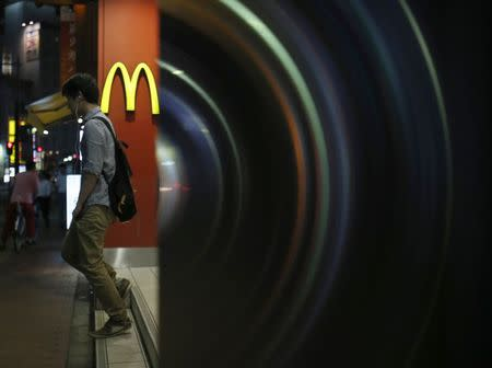 A customer walks out from a McDonald's store in Tokyo July 22, 2014. REUTERS/Yuya Shino
