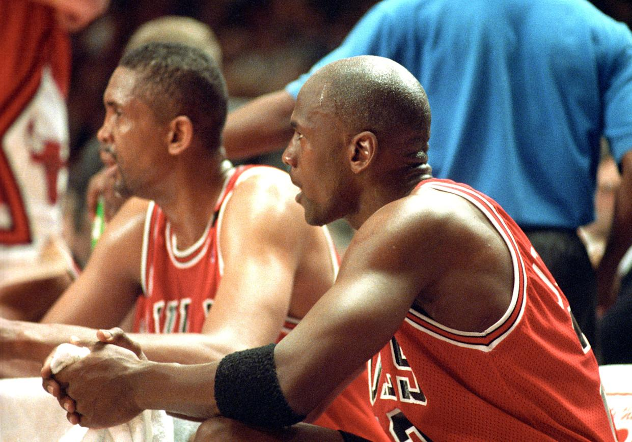 Chicago Bulls # 23 Michael Jordan  sitting next to Bill Cartwright on the bench during the Chicago Bulls vs New York Knicks game on May 14 , 1993 at Madison Square Garden. (Photo by Tom Berg/WireImage)