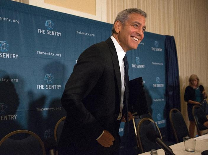 """George Clooney speaks at a news conference in Washington, DC, to present a report """"War Crimes Shouldn't Pay: Stopping the looting and destruction in South Sudan"""" (AFP Photo/Molly Riley)"""