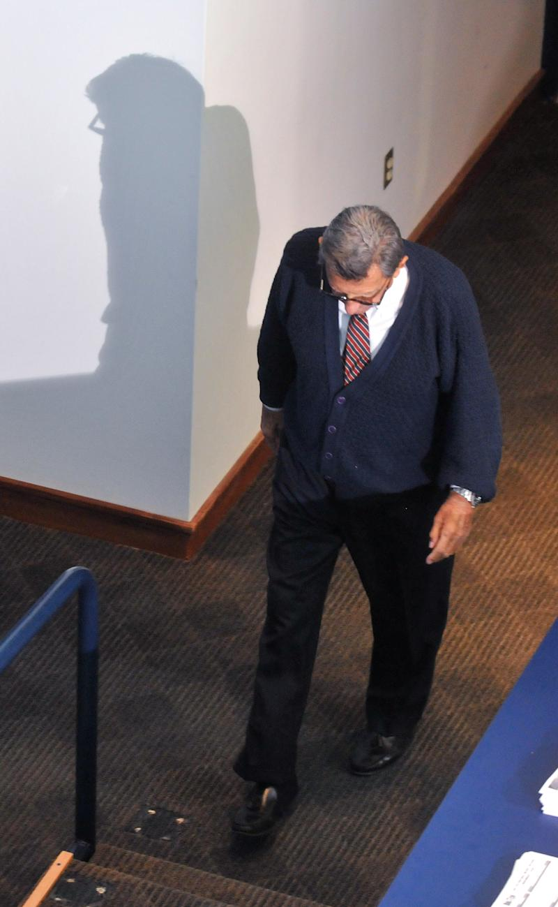 Penn State head football coach Joe Paterno enters his weekly news conference on Tuesday, Nov 2, 2010 in State College, PA.  Paterno has enough things to worry about beside going after his 400th career victory. So in typical fashion, Penn State's Hall of Fame coach downplayed questions Tuesday at Beaver Stadium about approaching his latest milestone when the Nittany Lions face Northwestern this weekend. (AP Photo/Pat Little)