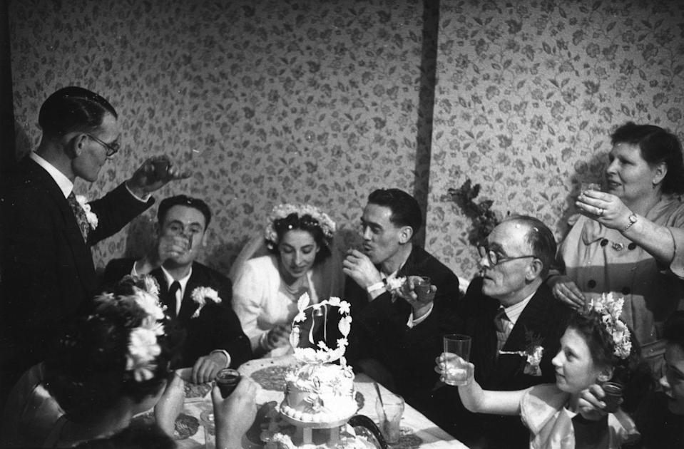 <p>In this circa-1952 wedding, guests didn't have to go far to find a glass to raise in tribute to the happy couple — the festivities took place at a pub.</p>