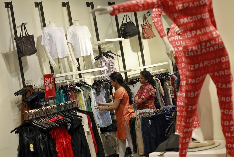 People shop for clothes at a store during a seasonal sale inside a shopping mall in Mumbai