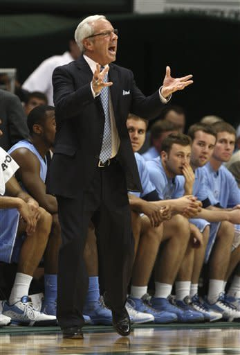 North Carolina head coach Roy Williams yells during the first half of an NCAA college basketball game against Miami, Wednesday, Feb. 15, 2012, in Coral Gables, Fla. (AP Photo/Lynne Sladky)