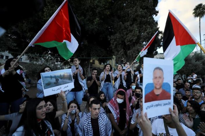 FILE PHOTO: People take part in a protest as they support the six Palestinian militants men who had escaped from Gilboa prison earlier this week in Nazareth