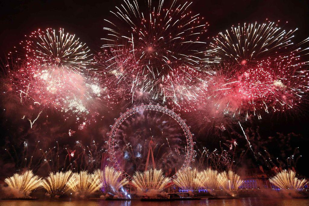 Fireworks explode around the London Eye during New Year celebrations in central London January 1, 2013.