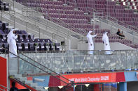 Empty stands are seen at the Khalifa International stadium 20 minutes before the start of competitions during the World Athletics Championships Friday, Sept. 27, 2019, in Doha, Qatar. (AP Photo/Martin Meissner)