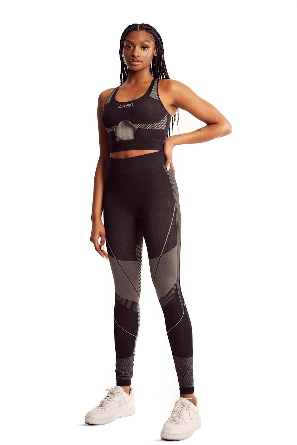 """<p><strong>LAPP </strong></p><p>lappthebrand.com</p><p><strong>£100.00</strong></p><p><a href=""""https://www.lappthebrand.com/collections/2020-leggings/products/black-seamless-legging?variant=32112835428442"""" rel=""""nofollow noopener"""" target=""""_blank"""" data-ylk=""""slk:Shop Now"""" class=""""link rapid-noclick-resp"""">Shop Now</a></p><p>Creative director <a href=""""https://www.harpersbazaar.com/fashion/models/a27042294/leomie-anderson-new-victorias-secret-angel/"""" rel=""""nofollow noopener"""" target=""""_blank"""" data-ylk=""""slk:Leomie Anderson"""" class=""""link rapid-noclick-resp"""">Leomie Anderson</a> jumpstarted her sportswear line in 2016, after building a community with her blog-turned-digital magazine that focused on empowering women. The Victoria's Secret Angel began posting articles centered on equipping young women with insight and knowledge for finding a voice when faced with unfair treatment, prejudice, and pressure. Since launching her first sportswear collection, focused on reclaiming the word """"no,"""" the <em>Forbes </em>30 Under 30 entrepreneur has expanded her designs to include geometric cut out tops, figure conforming leggings and easy sweatsuits. </p>"""