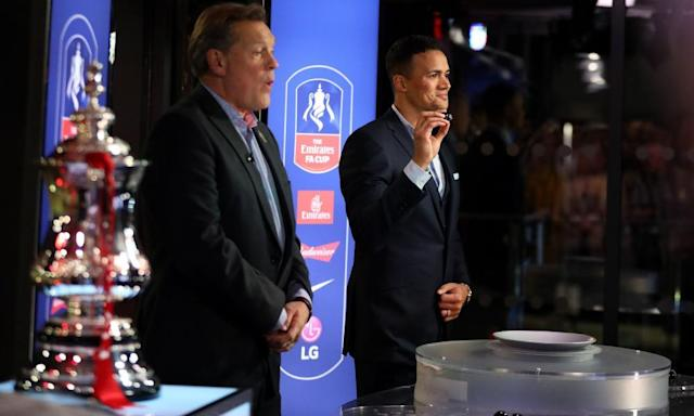 """<span class=""""element-image__caption"""">Jermaine Jenas and Glenn Hoddle making the FA Cup third-round draw, in which video assistant referees will be used for the tie between Brighton and Crystal Palace.</span> <span class=""""element-image__credit"""">Photograph: Steven Paston/PA</span>"""
