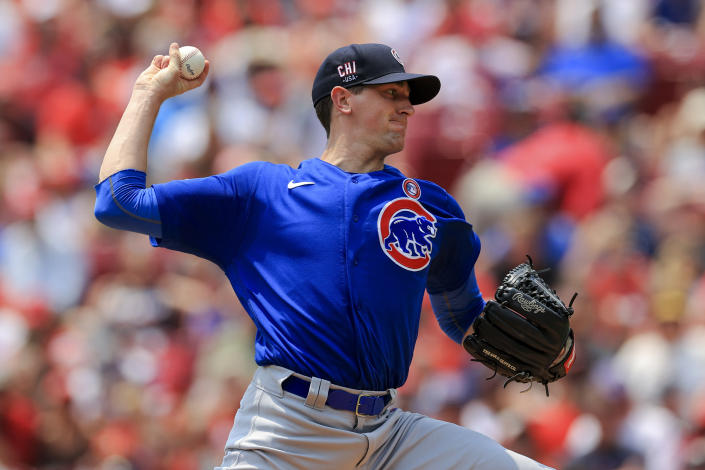 Chicago Cubs' Kyle Hendricks throws during the first inning of a baseball game against the Chicago Cubs in Cincinnati, Sunday, July 4, 2021. (AP Photo/Aaron Doster)