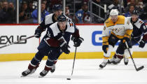 Colorado Avalanche right wing Joonas Donskoi, front, drives down the ice with the puck with left wing Andre Burakovsky, back left, and Nashville Predators center Colton Sissons trailing during the third period of an NHL hockey game Thursday, Nov. 7, 2019, in Denver. Colorado won 9-4. (AP Photo/David Zalubowski)