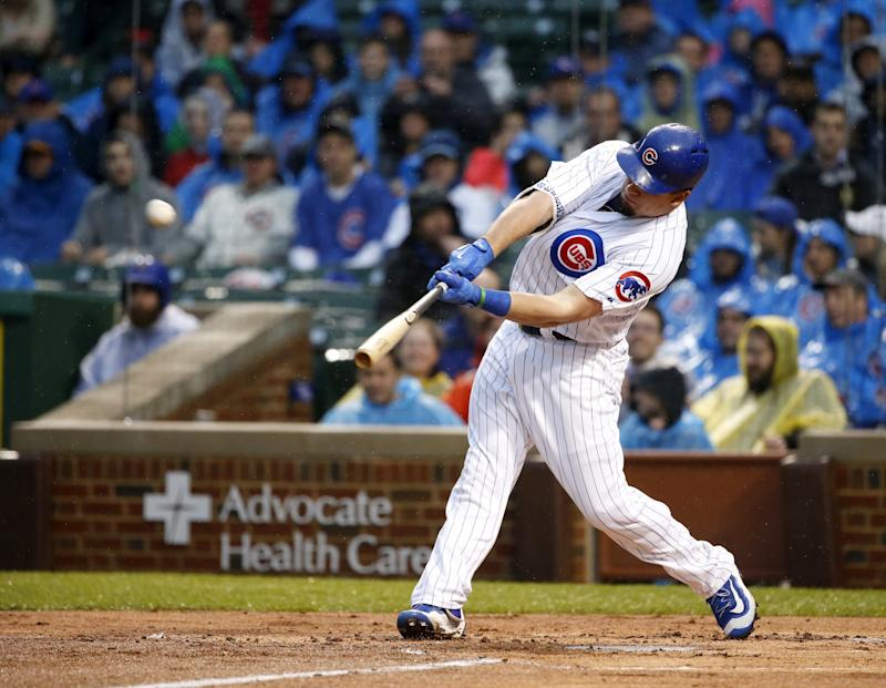 Kyle Schwarber bashed a Johnny Cueto pitch onto Sheffield Avenue. (AP)