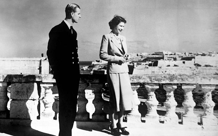 Princess Elizabeth, accompanied by the Duke of Edinburgh, looking over Valetta from the roof of the Villa Guardamangia, Malta - PA