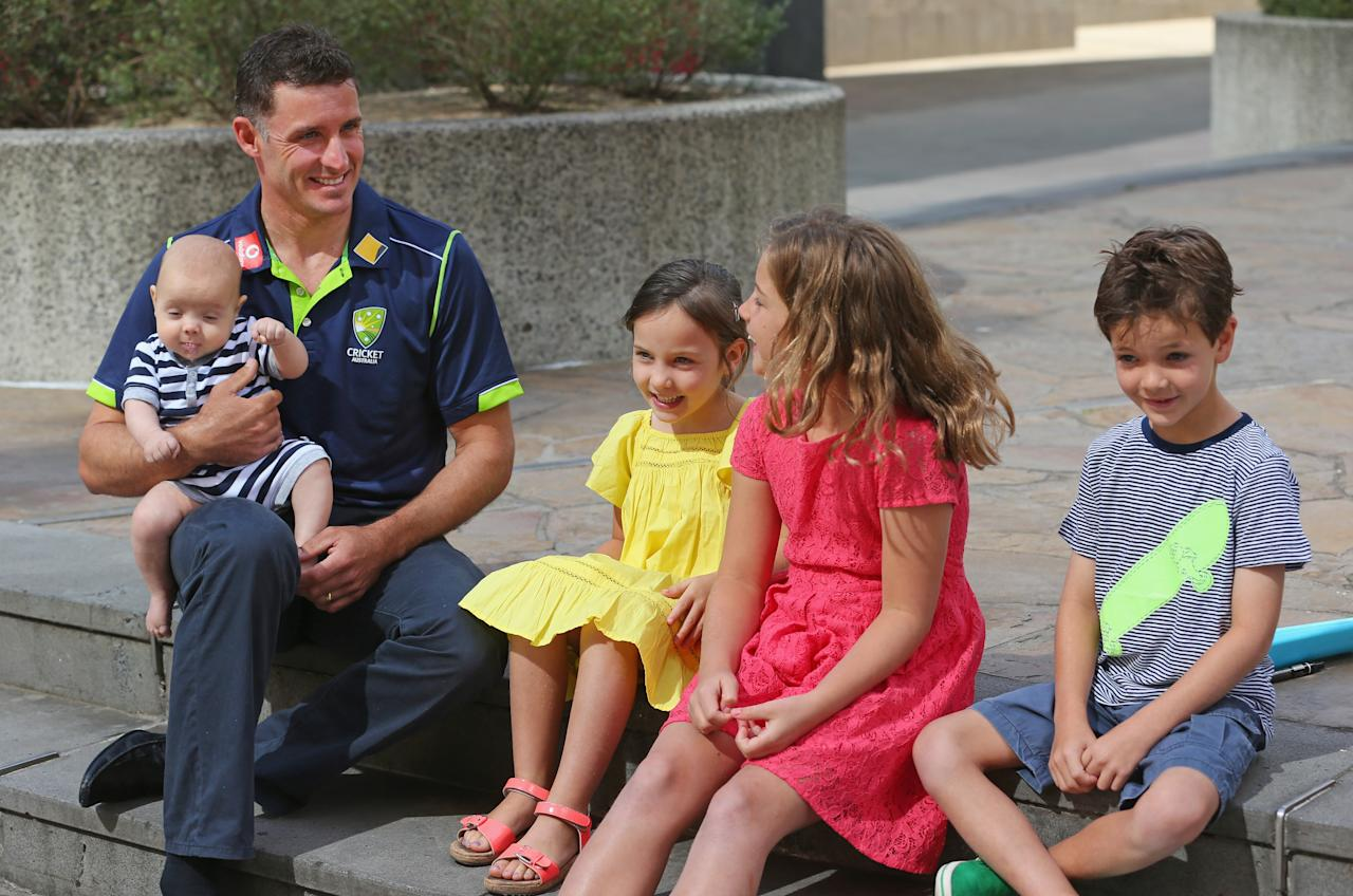 MELBOURNE, AUSTRALIA - DECEMBER 30:  Michael Hussey of Australia holds his son Oscar as he talks to his daughters Jasmin and Molly and son William after a press conference on December 30, 2012 in Melbourne, Australia.  Mike Hussey has announced that the third Vodafone Test against Sri Lanka in Sydney will be his last Test for Australia.  (Photo by Scott Barbour/Getty Images)