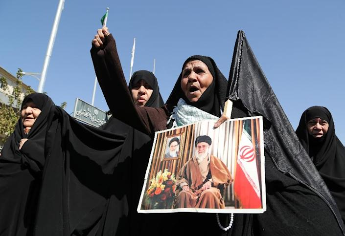 An Iranian protestor holds a picture of supreme leader Ayatollah Ali Khamenei during a demonstration against Saudi Arabia after 131 Iranian pilgrims were killed in a stampede at the annual hajj, on September 25, 2015 in Tehran (AFP Photo/Atta Kenare)