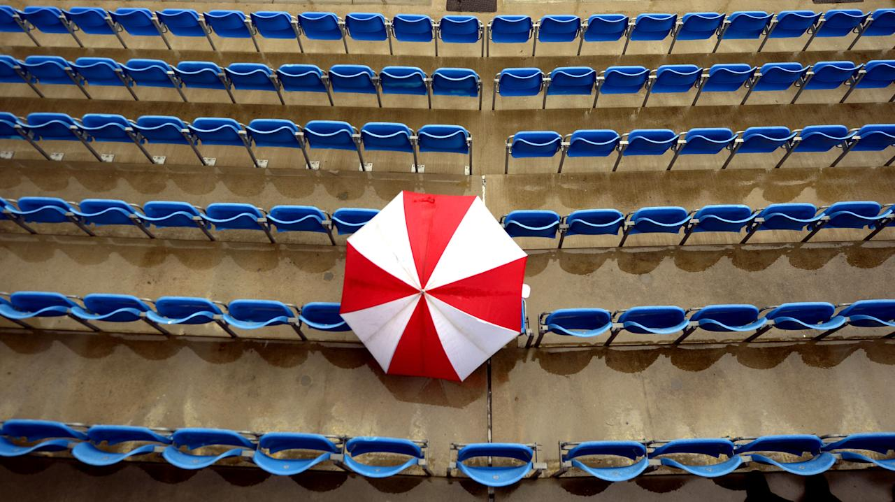Fans wait for the rain to stop at Headinley during the Second Investec Test match at Headingley, Leeds.