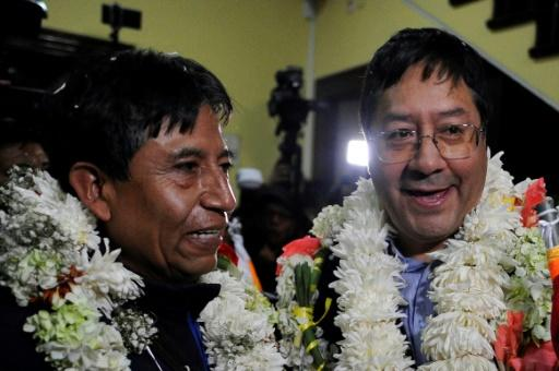 Bolivia's presidential candidate for the Movement for Socialism (MAS) party Luis Arce (R) speaks to reporters next to vice-presidential candidate David Choquehuanca (L) after the candidates' registration for May 3 general elections