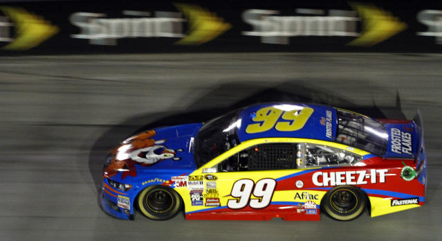 Driver Carl Edwards (99) makes his way through turn three during the NASCAR Sprint Cup series auto race at Bristol Motor Speedway on Sunday, March 16, 2014, in Bristol, Tenn. Edwards won the race. (AP Photo/Wade Payne)