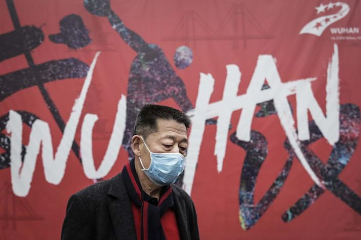 Wuhan residents have been told they must wear masks in public places as officials battle to halt the spreads of the disease: Getty