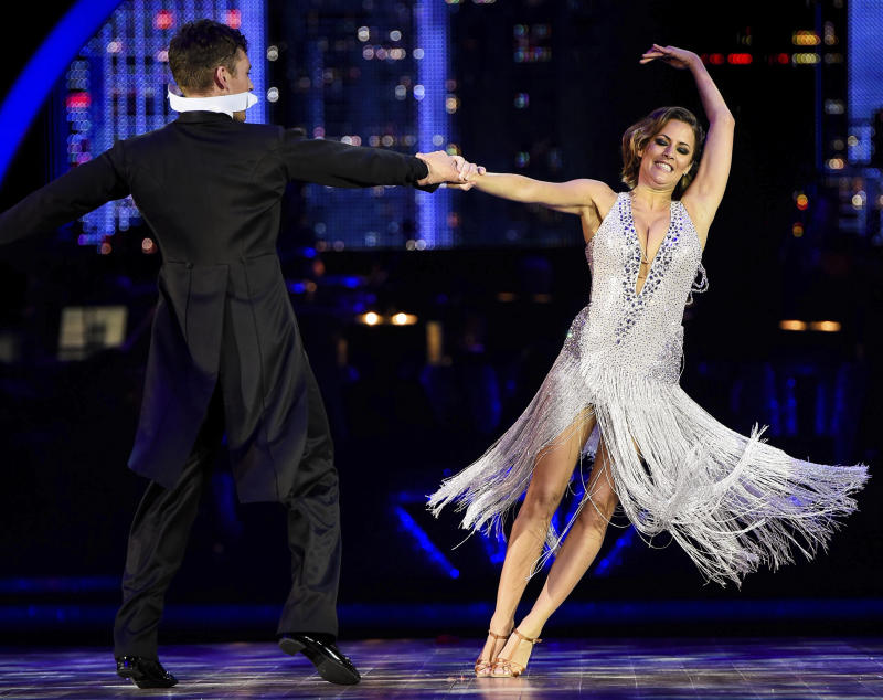English television presenter Caroline Flack and her partner, Irish dancer Tristan McManus, are pictured on opening night of the Strictly Come Dancing Live Tour, at Birmingham's National Indoor Arena. JANUARY 16th 2015 REF: FLW 15157 Credit: Matrix/MediaPunch /IPX