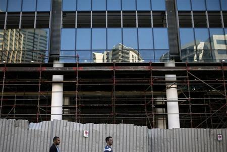 Residents walk past a deserted building site during a strike by construction workers in Cape Town
