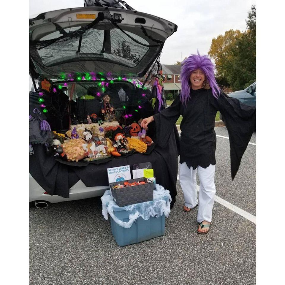 """<p>Who says that you have to follow a specific theme for your trunk-or-treat set up to be cool? This basic Halloween look is perfect. Toss in a few <a href=""""https://www.amazon.com/Winlyn-Artificial-Halloween-Thanksgiving-Decorating/dp/B07W1NSF2C?tag=syn-yahoo-20&ascsubtag=%5Bartid%7C2089.g.33658548%5Bsrc%7Cyahoo-us"""" rel=""""nofollow noopener"""" target=""""_blank"""" data-ylk=""""slk:plastic pumpkins"""" class=""""link rapid-noclick-resp"""">plastic pumpkins</a>, gourds, and <a href=""""https://www.amazon.com/jollylife-Giant-Spider-Halloween-Decorations/dp/B07F8QTB5Z?tag=syn-yahoo-20&ascsubtag=%5Bartid%7C2089.g.33658548%5Bsrc%7Cyahoo-us"""" rel=""""nofollow noopener"""" target=""""_blank"""" data-ylk=""""slk:oversized spiders"""" class=""""link rapid-noclick-resp"""">oversized spiders </a>with <a href=""""https://www.amazon.com/Creepy-doorways-entryways-Halloween-Spiders/dp/B00NWEGFPU?tag=syn-yahoo-20&ascsubtag=%5Bartid%7C2089.g.33658548%5Bsrc%7Cyahoo-us"""" rel=""""nofollow noopener"""" target=""""_blank"""" data-ylk=""""slk:some webs"""" class=""""link rapid-noclick-resp"""">some webs</a> and you're set. The festive string lights really bring it to life.</p><p><a class=""""link rapid-noclick-resp"""" href=""""https://www.amazon.com/Diojilad-Halloween-Decorations-Operated-Decoration/dp/B07VGFPDWN?tag=syn-yahoo-20&ascsubtag=%5Bartid%7C2089.g.33658548%5Bsrc%7Cyahoo-us"""" rel=""""nofollow noopener"""" target=""""_blank"""" data-ylk=""""slk:Shop String Lights"""">Shop String Lights</a></p>"""